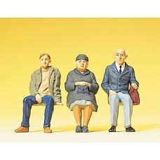 Preiser 63055 - Coated travelors sitting